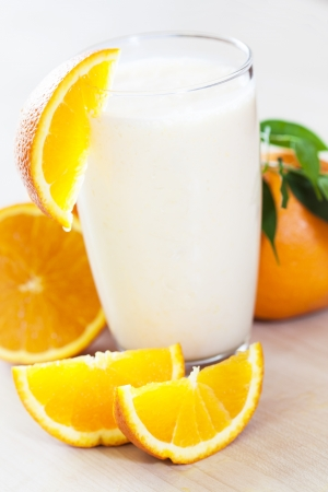 Milk shake with fruit -  orange  Stock Photo