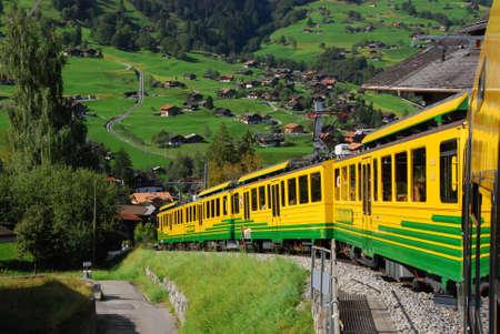 Swiss train descending from Wengen, Switzerland Editorial