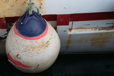 fishing cabin: Buoy of protection of boat hull Stock Photo