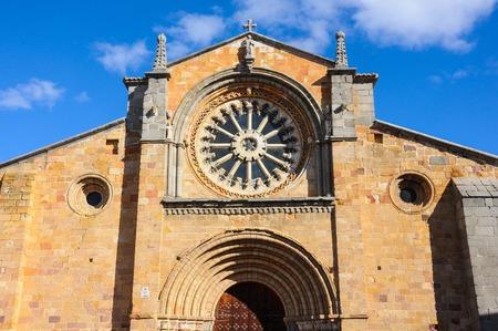 Front facade and facade of the Romanesque Church of Saint Peter. Avila, Spain