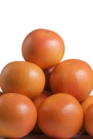 close up of a pyramid of grapefruits on white background Stock Photo