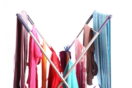 colorful clothes hanged for drying after laundry clothes airer, clothes dryer isolated on white