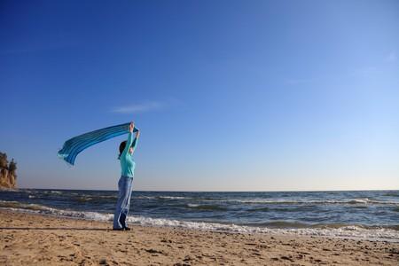 blue woman and shawl at sea shore Stock Photo - 8227673