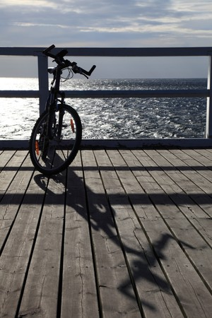 murk: Bike at the pier, jetty in morning sea