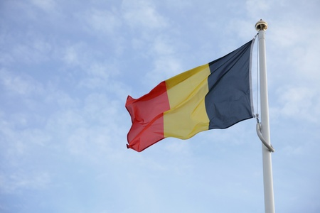 Belgium flag of on blue sky background Stock Photo - 8356371