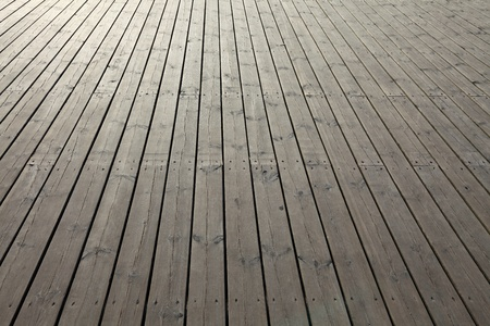 Wooden planks that make up a large pier.  Stock Photo