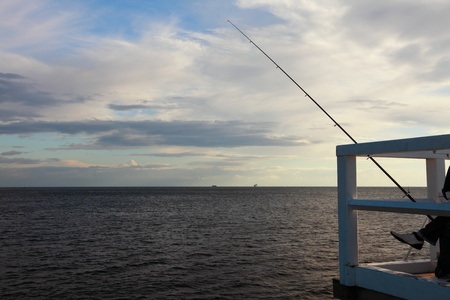 fishing rod, sea and sky at the pier, jetty Stock Photo - 8445925