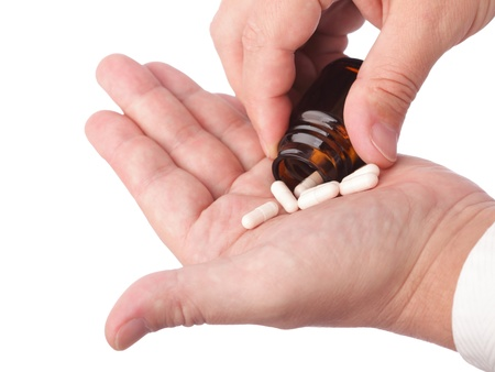 man with pill - blue white pills in man hand isolated