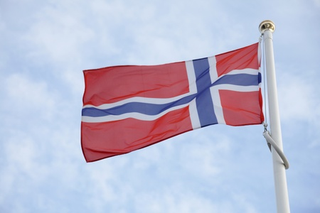 Norway flag of on blue sky background Stock Photo