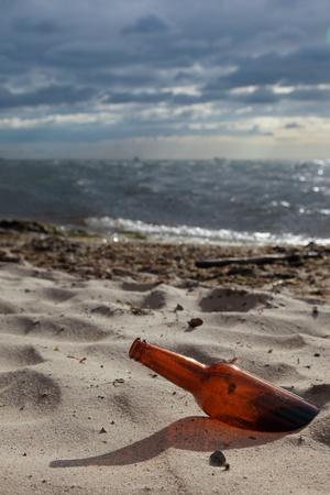 bottle on beach sea and sky