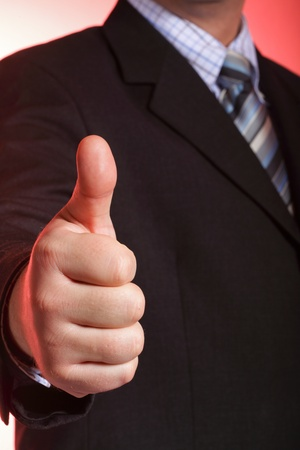 Business man showing thumb up - selective focus on hand Stock Photo - 9615153
