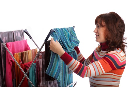 colorful clothes hanged for drying after laundry clothes airer, clothes dryer isolated on white and woman Stock Photo