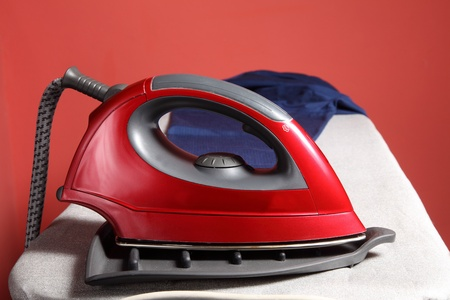 drudgery: household chores - red iron  and navy blue shirt
