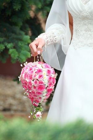 wedding bunch in woman hand outdoor photo