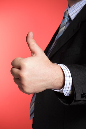 Business man showing thumb up - selective focus on hand Stock Photo - 10144134