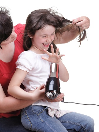 woman and Little girl dries hair, daughter isolated on white photo