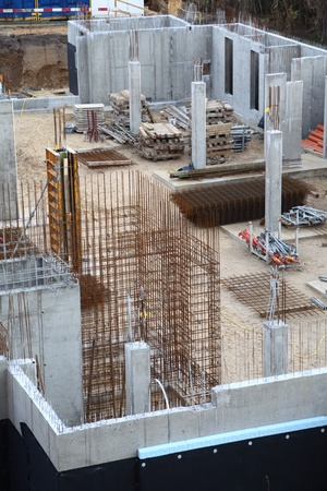 construction building site pouring concrete in form sand photo