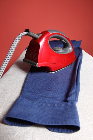 household chores - red iron  and navy blue shirt   photo