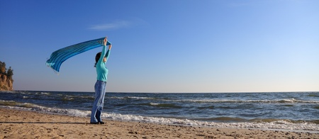 blue woman and shawl at sea shore photo