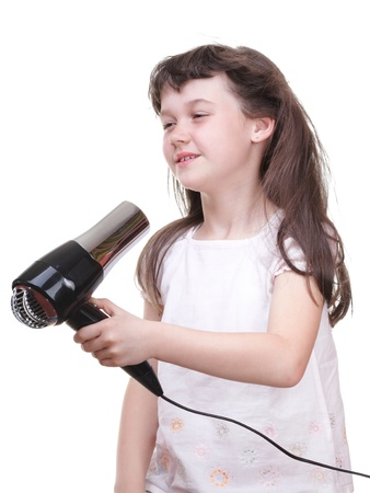 little girl posing with hair dryer isolated on white photo