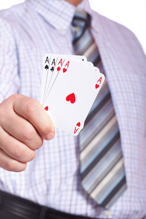 man and playing cards in hand isolated photo