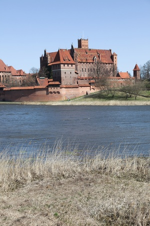 Malbork castle in Pomerania region of Poland.Teutonic Knights' fortress also known as Marienburg. Nogat river. Stock Photo - 11406609