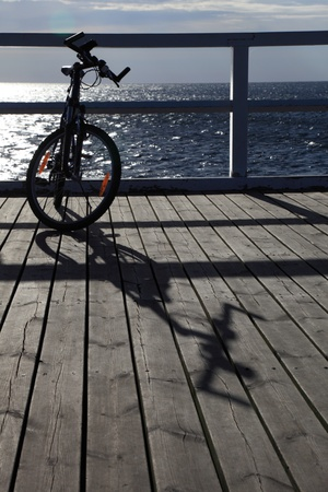 mountainbiking: Bike at the pier, jetty in morning sea