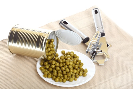tinned: Tin opener opening a can of food canned, tinned peas