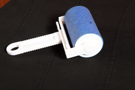 lint: ready cleaning dust with lint roller Stock Photo