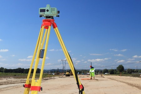 Builders level - construction site by theodolite level transit equipment  Stock Photo