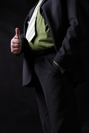 Business man showing thumb up - selective focus on hand Stock Photo - 11941787