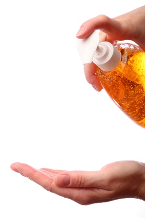 disinfect: Applying liquid soap. Two hands holding bottle with liquid soap isolated on white background.