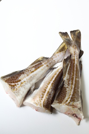 cod fish: Raw cod fish fillets in kitchen on white background Stock Photo