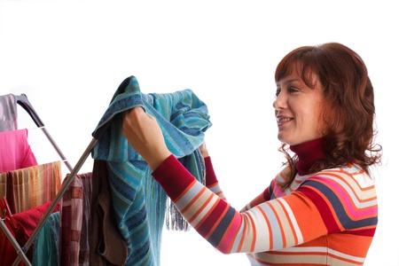 hanged woman: colorful clothes hanged for drying after laundry clothes airer, clothes dryer isolated on white and woman Stock Photo