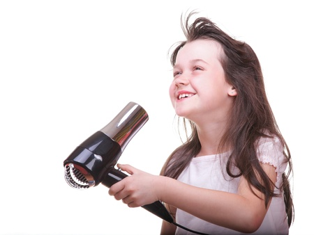 Pretty girl drying her hair hairdryer isolated on white Stock Photo