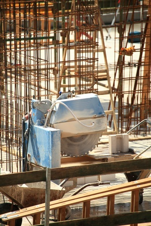 construction work of stone cutting by cut-off saw with diamond wheel photo