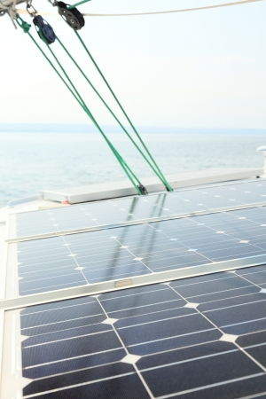 Solar charging batteries aboard a sail boat Photovoltaic panels energy concept photo