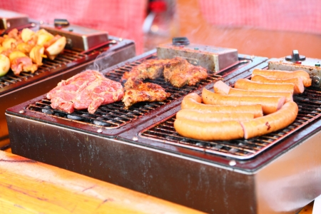 Grilled sausages and meat on the barbecue outdoor restaurant photo