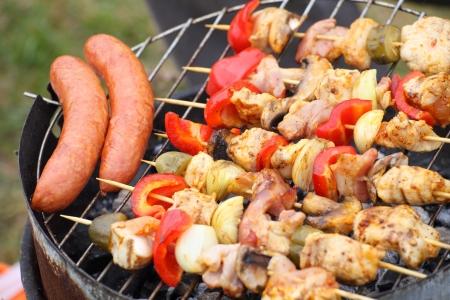 Flames grilling a steak on the BBQ bonfire, campfire summer