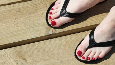 woman sandals: Female feet with flip-flops outdoor red nail