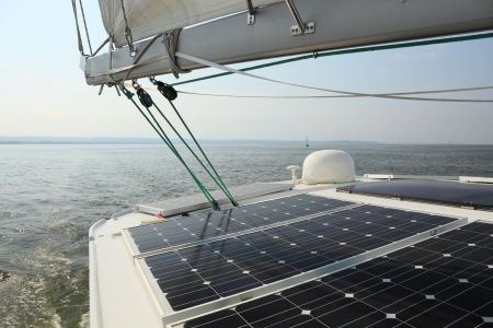 solar power plant: Solar charging batteries aboard a sail boat Photovoltaic panels energy concept