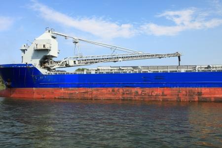 cranes in a port loading a ship coal photo