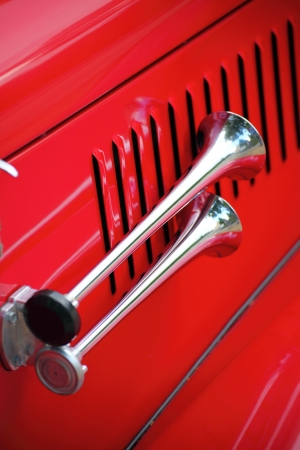 cropped image of a fully restored classic old car with lots of shiny chrome photo