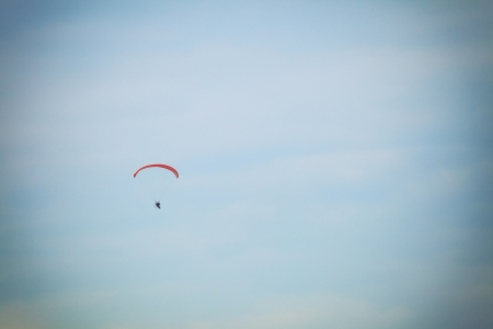 airplane ultralight: Moto paraglider low view of a motor para-glider blue sky