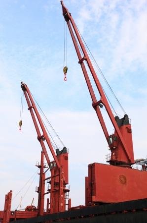 red port crane terminal seaport outdoor photo