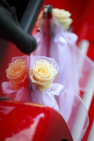 old red vintage car detail of red car door Bridal limousine handle with white decorations photo
