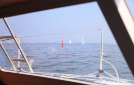 Boat porthole sailboat view blue ocean sea sky horizon outdoor sport photo