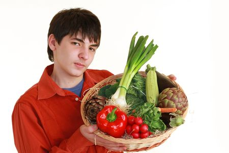 teenager with vegetables basket photo