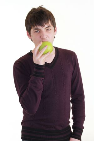 Young guy with green apple photo