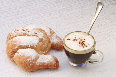 continental food: croissant and coffee